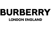 """<p>Burberry is a famous British clothing brand for men and women, whose story begins in the year 1856, when Thomas Burberry, opens his men's clothing store in Basingstoke, a town in the county of Hampshire.</p>  <p>The leading maison in the luxury goods market, boasts a tradition of over one hundred and fifty years of history, solemn awards of royal rank and the world of jet-set, for a sober and aristocratic """"Old England"""" style, which makes Burberry a immortal brand.</p>  <p>The brand is characterized by the logo of the equestrian rider wearing armored armor, which on the lance carries a banner bearing the Latin prorsum motto.</p>  <p>The best seller of the luxury brand is the """"gabardine fabric"""", the typical Burberry check and the well-known trench coat.</p>  <p>Thomas Burberry first invented the high-performance gabardine fabric, tear-resistant, waterproof but breathable, thanks to the particular type of Egyptian cotton thread processed with a secret procedure, and later woven with a tight weave and withdrawn in the same way, which revolutionizes the 'clothing for leisure, deserving the podium in the history of costume and fashion.</p>  <p>The classic Burberry check, the theme with crossed horizontal and vertical lines, appears for the first time in 1920, and is initially used in the waterproof linings, later, the checkered pattern, available in black, white, camel and red, then becomes the identification identification of the brand. In those years, the Company became a supplier of some expeditions to the North Pole and shortly after was involved in the creation of a new service uniform for British officers in the world war of 1918: thus born the legendary trench coat, literally trench coat, which 'years later it is made unforgettable in the film Casablanca, worn by Humphrey Bogart on the runway of the famous airport.</p>  <p>At its birth the trench was supposed to be a weatherproof raincoat and suitable for fighting, but today this raincoat has become the symbol o"""