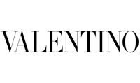 """<p>Valentino is the first high fashion and prêt-à-porter line by Valentino Garavani, who opens his first atelier in via Condotti in Rome in 1959.</p>  <p>The Italian designer initially collaborates with Jean Dessès and Guy Laroche and in the 60s he became a fashion king, consecrated on the pages of Vogue.</p>  <p>In the '70s, after having chosen the """"V"""" as the logo of its brand, it became synonymous with high class and tailoring.</p>  <p>Over the years Valentino, master of high fashion, presents collections of elitist evening dresses and great galà with impeccable cuts and luxury accessories for men and women.</p>  <p>The feminine dresses emphasize the hips and reveal the décolleté, enriched with jewels and romantic touches.</p>  <p>In 1967, he was awarded two honors in America: the Neiman Marcus Award in Dallas, equivalent to the Oscar for Fashion, and the Palm Beach Award for Palm Beach. Moreover, in the same year he presented the first Valentino Uomo collection.</p>  <p>In 2005 he was awarded the Légion d'honneur, the highest honor awarded by the French Republic, which is rarely granted to non-French personalities.</p>  <p>After 45 years of work, in 2007, he leaves the fashion house, giving way to the designer Alessandra Facchinetti, who in turn passed the scepter to the current creative directors of the brand, Maria Grazia Chiuri and Pier Paolo Piccioli.</p>  <p>Finally, on 12 July 2012, the fashion house was sold to the Mayhoola for Investments company in Qatar.</p>"""